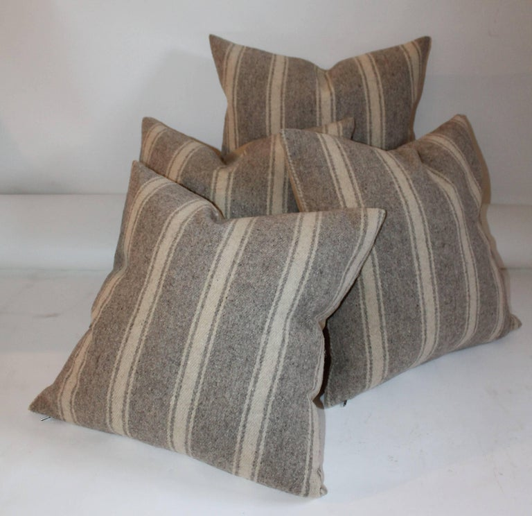 These handwoven striped saddle blanket weaving pillows are in fine condition. They have a soft cotton linen backing. Sold as a group of four.