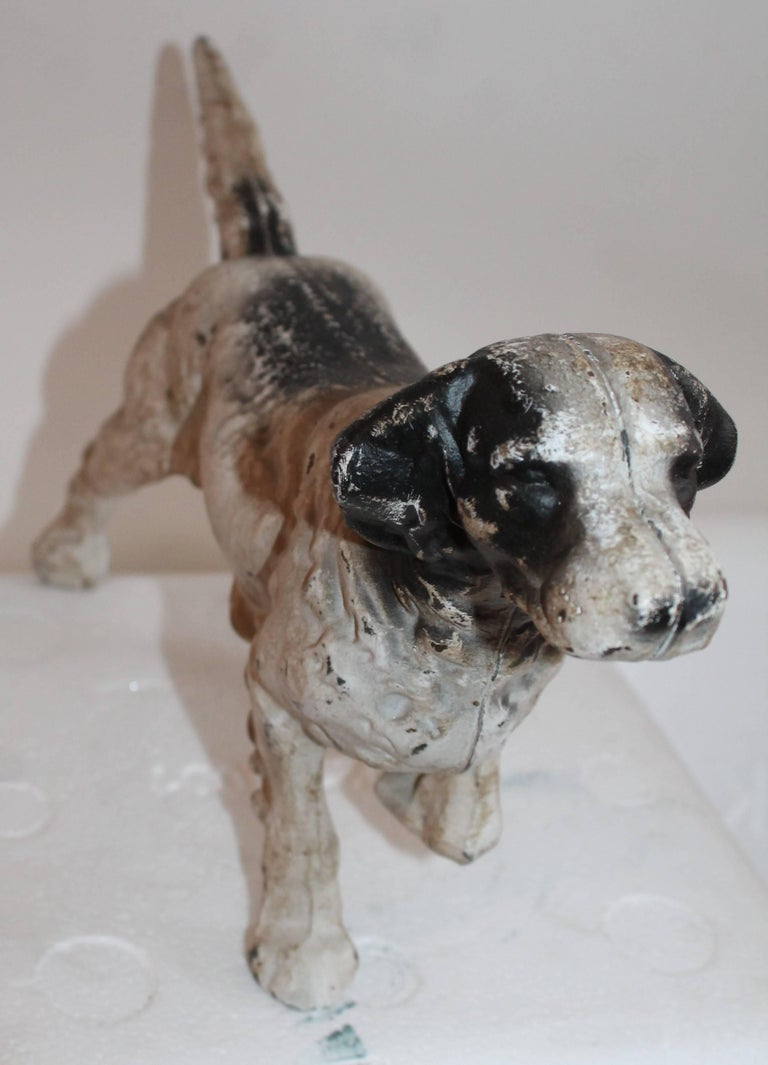 This original painted and slightly worn Hubley dog door stop is in great condition and is very heavy.