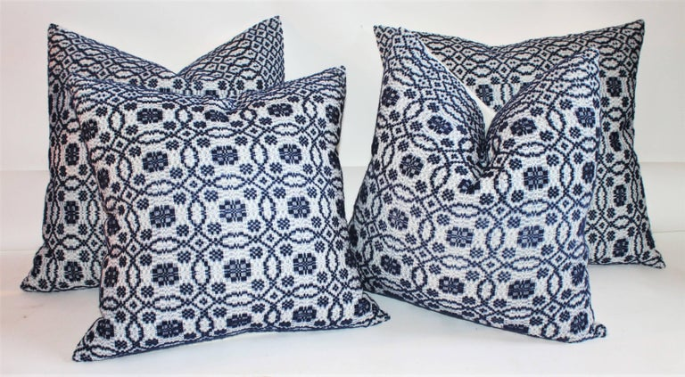These early 19th century woven coverlet pillows in indigo blue with crisp white cotton linen backing are in pristine condition. Sold as a group of four. We have two pairs of 20 x 20 and two pairs of 22 x 22 in stock.   Small pair 20 inches x 20