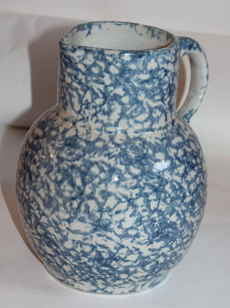 This most unusual form 19th century spongeware pottery pitcher in a soft sky blue. It reminds you of the ocean or clear ski blue. The condition is very good.