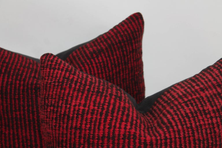 These organic and nubby red and black saddle blanket pillows are in great condition and sold as a pair. The backing are in black cotton linen.