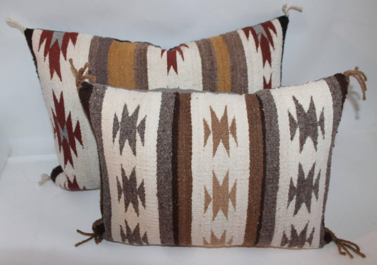 These Navajo Indian weaving pillows are in fine condition. These geometric pillows are two different patterns. Pillows measure: Large pillow 21 x 14 x 5 Small pillow 18 x 14 x 5.