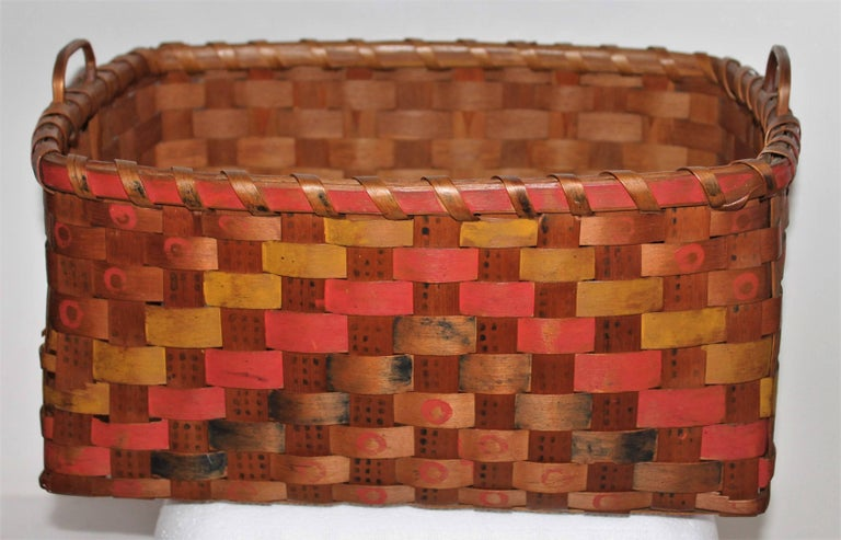 This fine example of 19th century original polychrome painted Maine Penobscot Indian basket is in good condition. There are minor breaks on the edge in few areas, but are not bad at all. This double handled basket comes from a private family