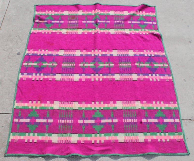 1909 Cayuse Pendleton blanket with vibrant rare colors. This blanket has wear consistent with age and use. There are two minor old repairs to the blanket. The label on this Pendleton is in amazing condition and is the original label.