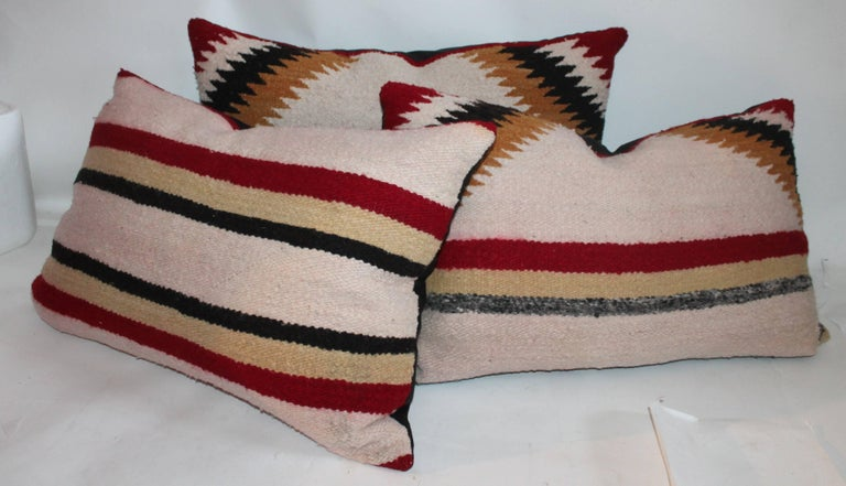 This set of three Navajo saddle blanket pillows are all from one saddle blanket.