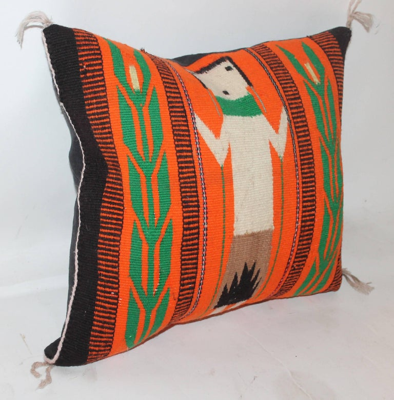 Navajo Indian weaving with a vivid orange back round color. This small gem is in Fine condition and is quite rare or unusual to see. The backing is in black cotton linen.