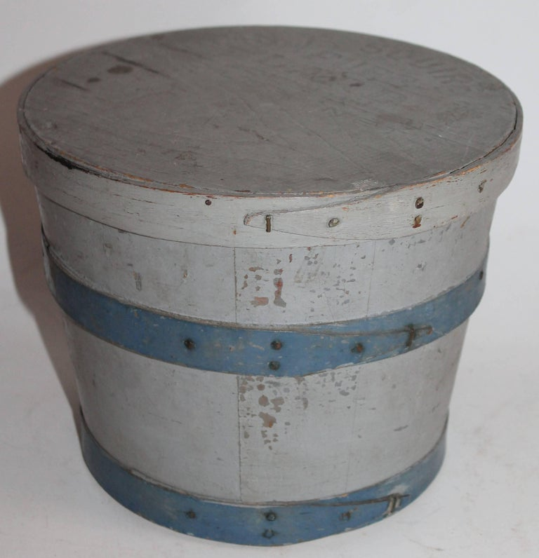This 19th century lard bucket in original blue and grey painted surface is in fine as found condition. The lid is stamped P.Square Pure Lard Co. under the painted surface. Fantastic striped surface.