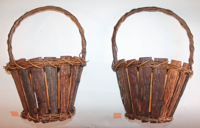 These cool half round wall baskets are in pristine condition and very sturdy.