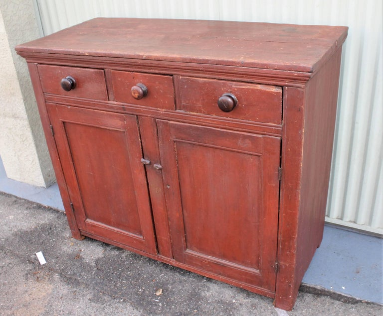 This original red painted jelly cupboard with original three drawers over two doors. The condition is very good.