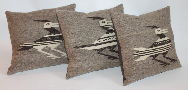This group of Indian weaving road runner pillows are in brown and tan and in very good condition. Sold as a group of three. The backings are in brown cotton linen.