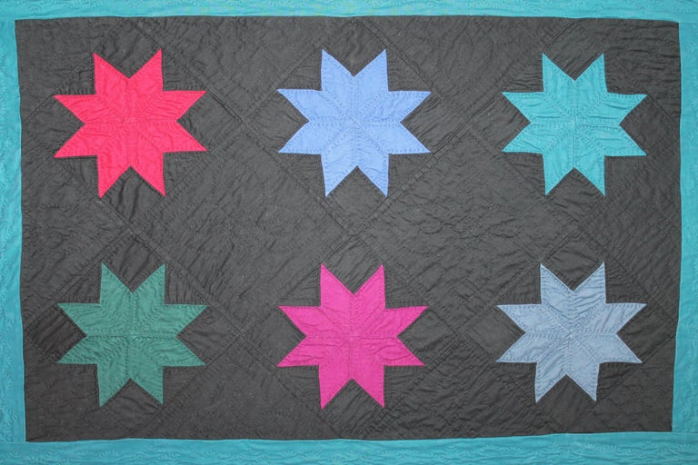 This fine Ohio Amish eight point stars is in fine condition with a grey chambray backing. This little rare gem has nice tight stitching and wonderful piece work as well. It is rare to find these forties crib quilts in fine condition. Ready for