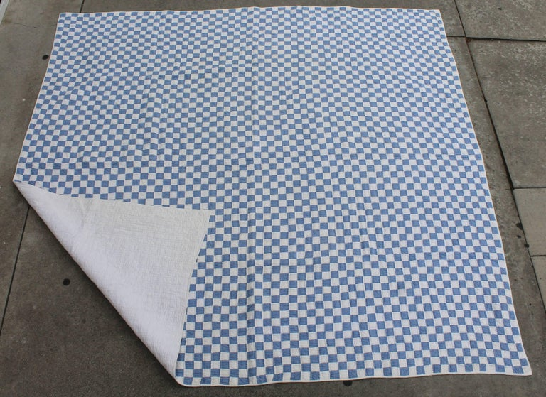 This large quilt in blue and white small pieces is in great condition and nicely pieced. This quilt would fit a queen or king bed.