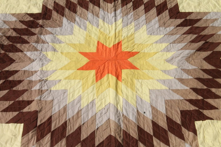 Eight point star quilt in Western colors. Indian sunset broken star quilt. This quilt is in pristine condition and will fit a queen or king bed. The piecing and quilting is very good.