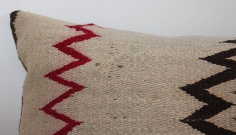 This fine Navajo Indian weaving bolster pillow is in good condition. The backing is in a cotton tan linen.