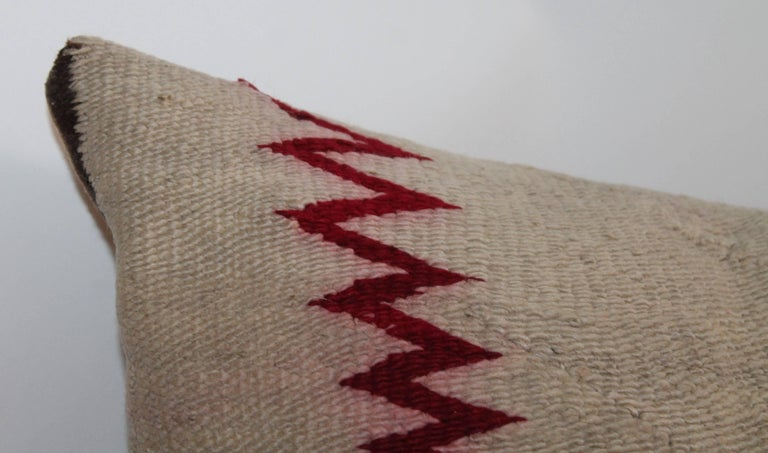 This fine weaving has the streak of lighting borders is in good condition and has a tan cotton linen backing.