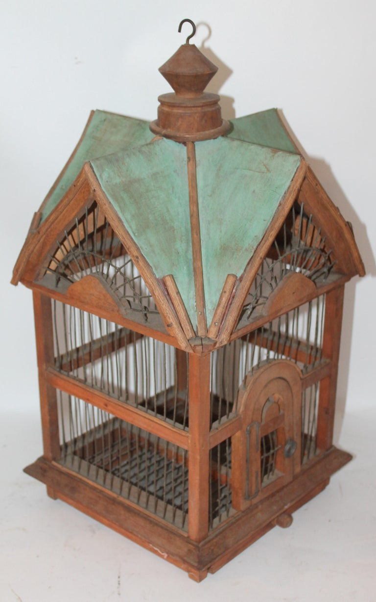 This painted and wire midcentury folky bird house was found in the mid west. The condition is good with wear consistent from age and use.