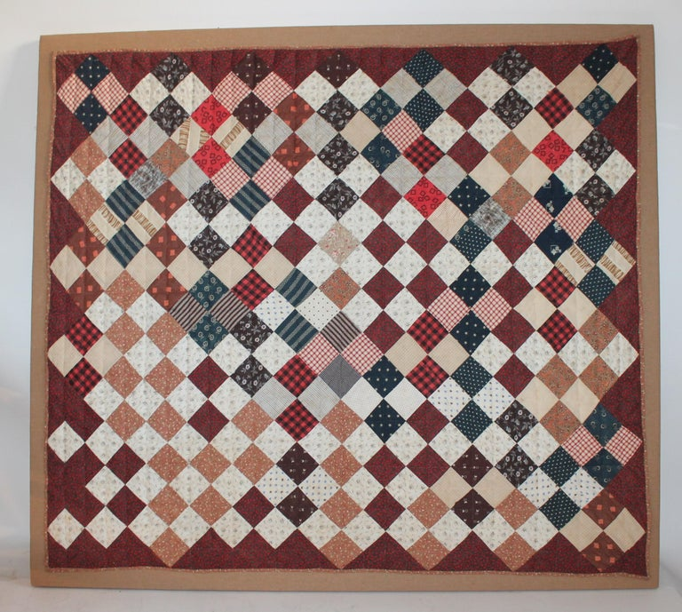 19th century one patch crib quilt hand-sewn on linen and on stretcher frame. This is in fine condition and is from Lancaster County, Pennsylvania.