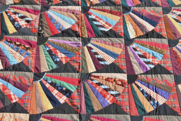 19th century crazy fan quilt contained in squares. The condition is very good and lots of amazing details throughout the quilt. This quilt is from Lancaster County, Pennsylvania.