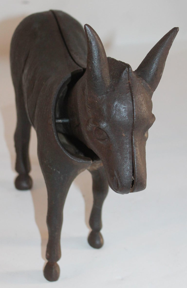This folky and heavy donkey door stop is in fine condition and in working order. The head bobs back and forth when moved. It has a wonderful untouched patina.