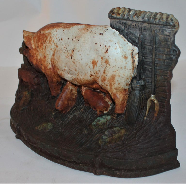 19th century original painted momma pig and baby pigs cast iron doorstop. Possibly a Hubley. Its unsigned.