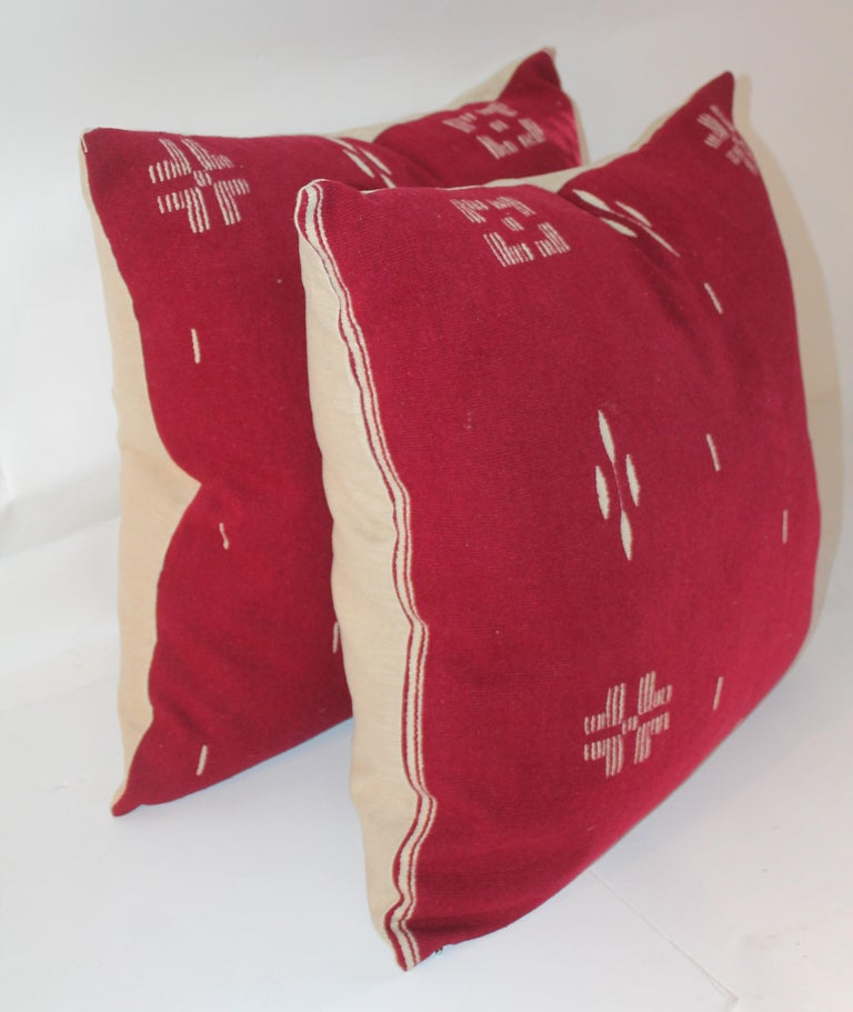 These most unusual burgundy and white Indian design pillows are in fine condition. The backing is in cream cotton linen. Down and feather fill.