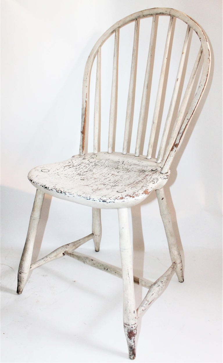 This fine original painted balloon back Windsor chair is in great untouched surface paint. This chair was found in Pennsylvania but is from or made in New England.