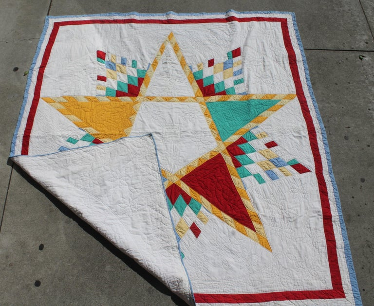 This amazing Northeastern Star quilt is in Fine condition with Fine quilting and piecework. This fine five point star was found in Berks County, Pennsylvania.