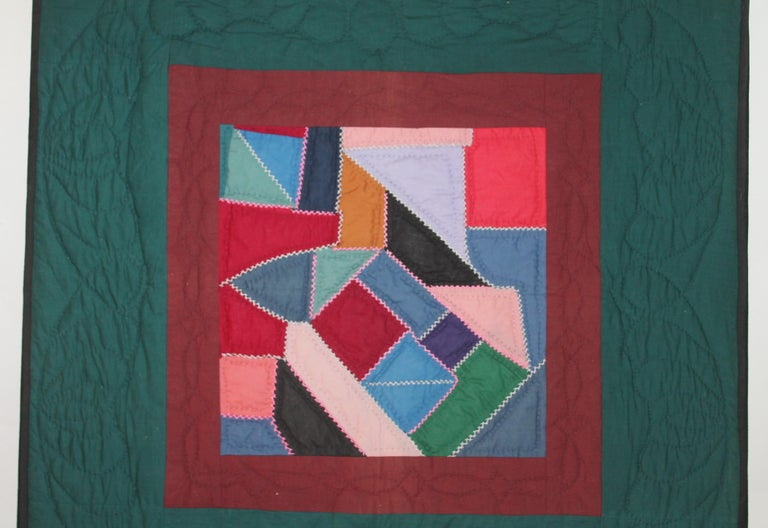 This late but great combination wool and cotton contained crazy quilt is in good condition with minor wear to the binding. This crib quilt was hand sewn on linen and mounted on a stretcher frame. Ready for hanging in your home. It was from a private