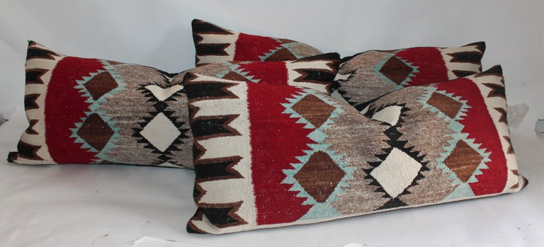 Navajo Indian weaving bolster pillow with black linen cotton backing. These amazing geometric Indian weaving contains turquoise, red and brown, black and cream. So unusual pattern and colors. There are four bolsters in stock. They are $1195. Each or