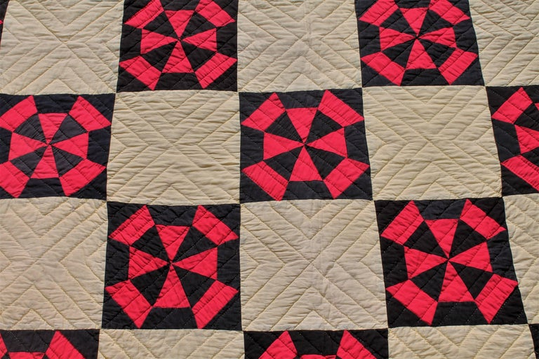 This fine large black and red pinwheel pattern quilt is in good condition with a double inner border and very nice piece work. The quilt has nice tight quilting and is supper graphic.