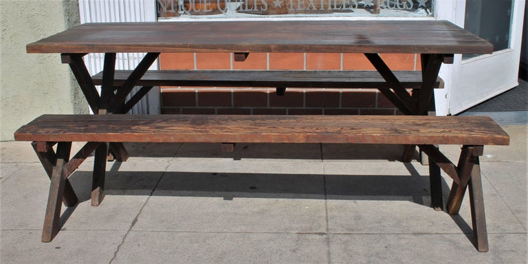 This rustic table measures 70 wide x 27 deep x 27 high. This set was found at a cabin at Big Bear. It has a wonderful worn and mellow patina.