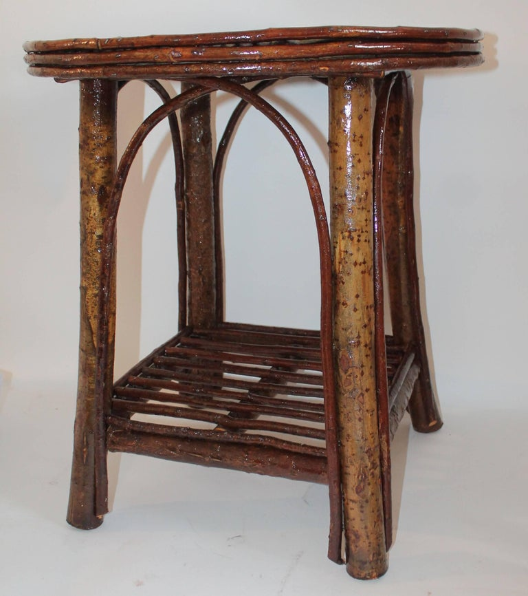 Adirondack hickory rustic twig side table. This cool little birch bark covered twig table is in good sturdy condition.
