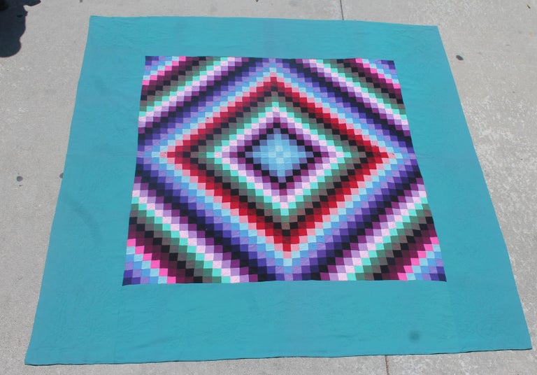 This colorful mixed fabrics quilt contains cottons, wool and wool crepe. The condition is good with minor wear spots or bites. The piece work is very good and fine quilting. The backing is in calico black and white fabric. This is a Lancaster County