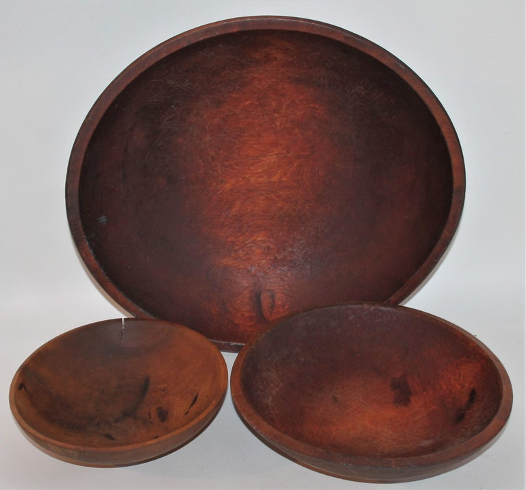 14 diameter x 4 high. These three butter bowls were found in New England and are all in fine condition. Sizes are as listed and sold as a collection of three. Measures: 10 diameter x 2.5 high 8 diameter x 2 high.