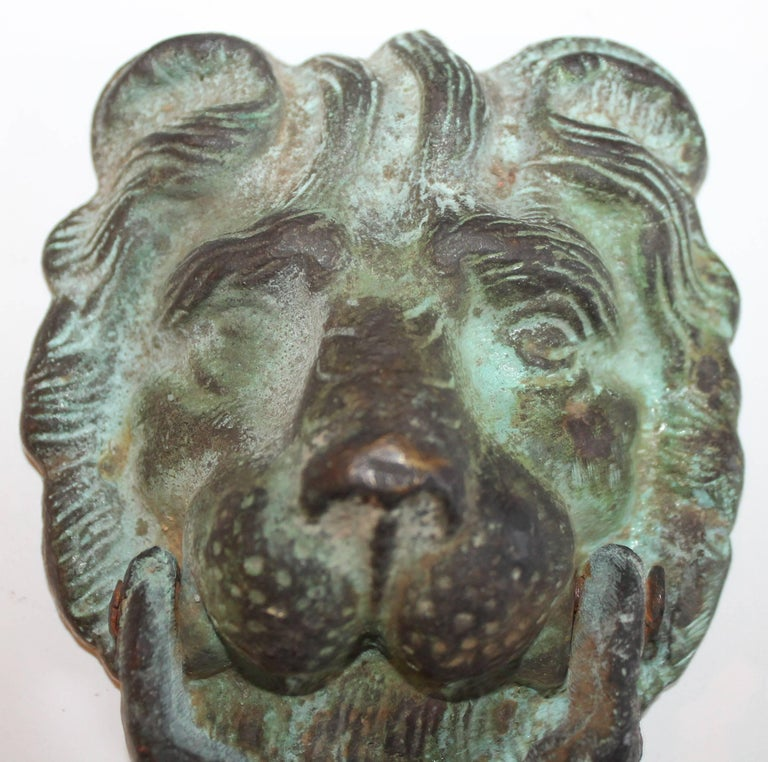 19th century lion door knocker. This door knocker is in great condition and has wear consistent with age and use. There is great patina to the bronze. Great working condition.
