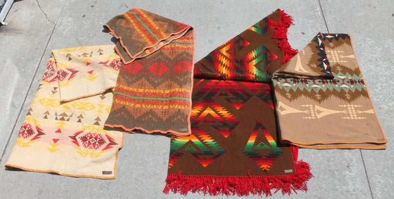 Small rectangular Pendleton - 74 x 20     This fine collection of Indian design camp blankets are all in good condition and all have the original Cayuse Pendleton labels Measures: Yellow Pendleton - 74 x 56 Red fringe Pendleton - 64x62 Brown