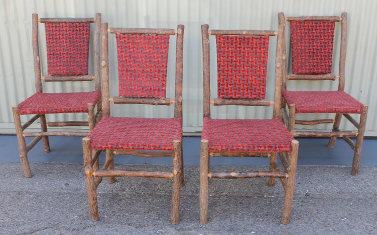 This set of matching Old Hickory chairs from Martinsville, Indiana are in pristine condition and upholstered in a red striped cord fabric. They are very sturdy and comfortable.