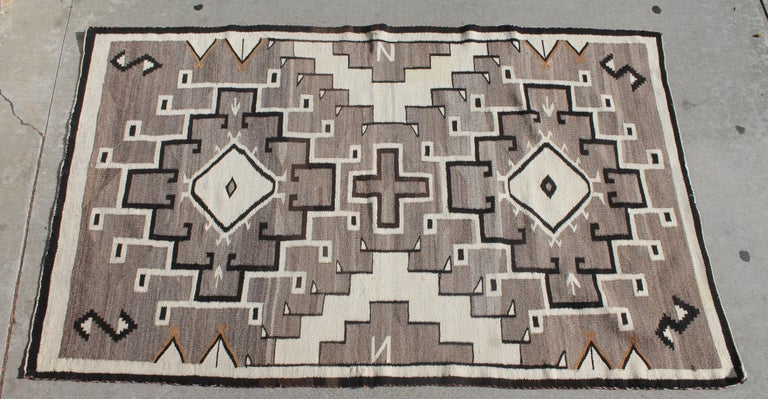This fine American Indian weaving is a great example of a great geometric Navajo rug. The condition is very good.