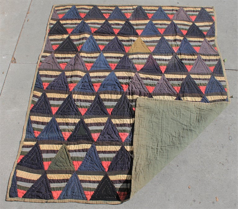 Afro American wool strips quilt. The pattern is roman stripes. This is a folk art quilt with rough quilting and is a crude quilt with crude piecing. Typical of an Afro American Quilt.
