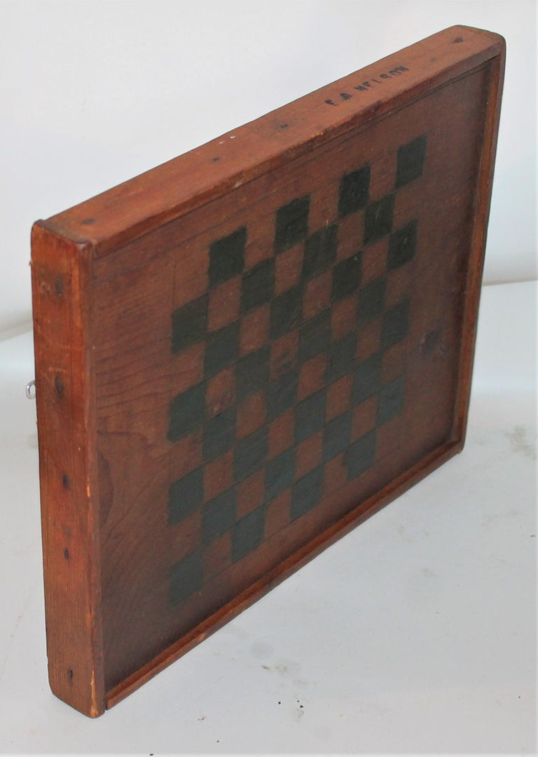 19th century original natural surface and painted game board from PA. The board is signed