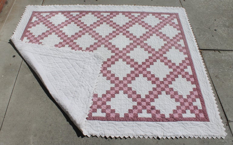This fine triple Irish chain quilt is a king-size and great condition. The quilting is fine as well as the piecework. The binding is triangles on all four sides.