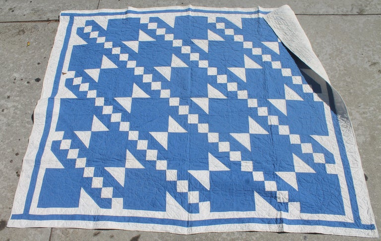 This unusual blue color is a fantastic pattern and fine quilting. The inner border frames it well. This is a smaller quilt and great for hanging.