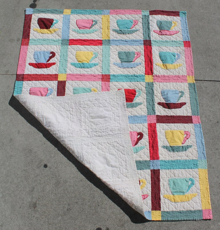 This midcentury coffee cup applique quilt is in fine condition with multicolored coffee cups and tight quilting. Great for hanging in a cafe or coffee shop. The condition is very good.