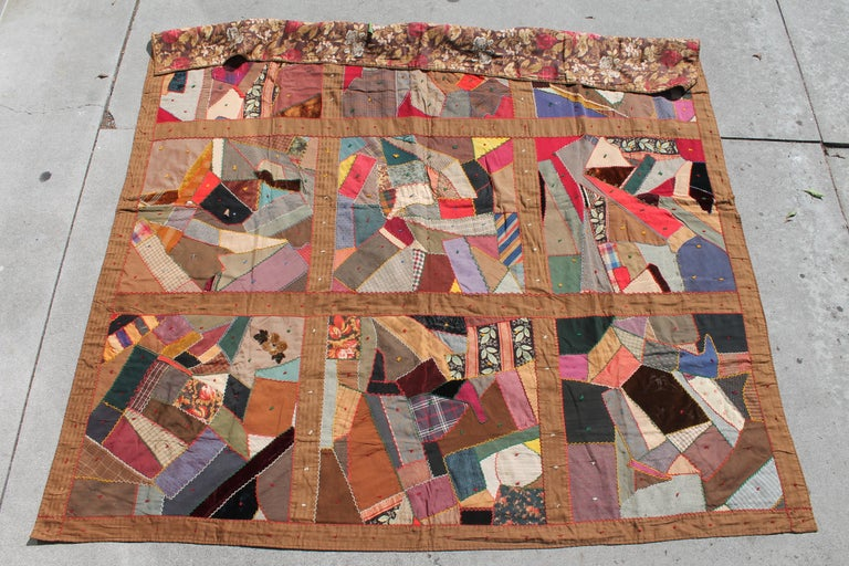This fantastic crazy quilt is made up from wool and velvets fabrics. The backing is in a wild 19th century tropical printed wool Chalis fabric. The condition is very good. Found in Lancaster County, Pennsylvania. It consists of great fabrics!