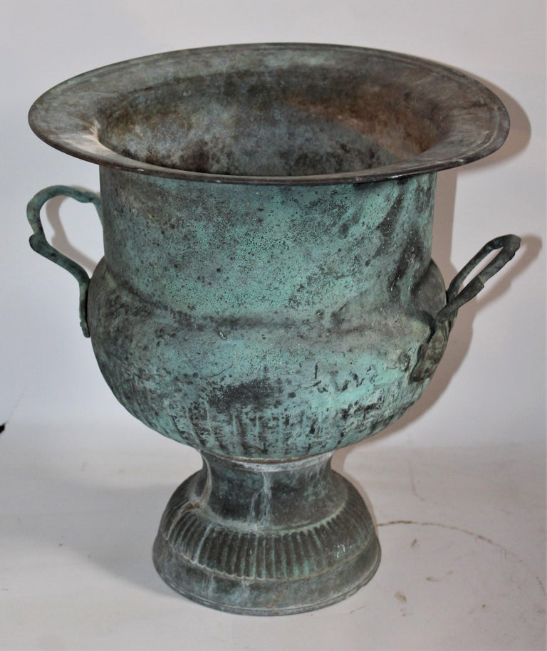 This copper urn has a amazing untouched copper patinated surface and double handles. The condition is very good.