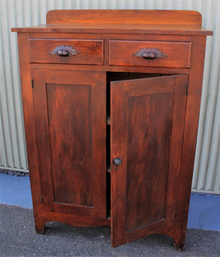 19th century pie safe in original stained surface. This beautiful pie safe has been checked for strength and stability. The cupboard is in fine condition and the original tins are good as well. Everything is all original.