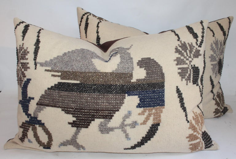 These folk Mexican Indian weaving big bolster pillows with folky embroidered eagles. The backings are in colored brown linen. Individually 895.00.The pair 1475.