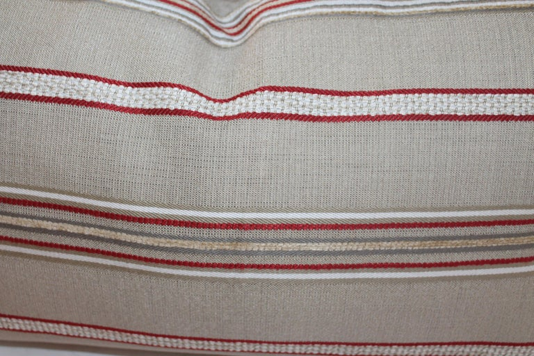 Vintage red and tan ticking bolster pillows. Sold as a pair only. Condition is very good.