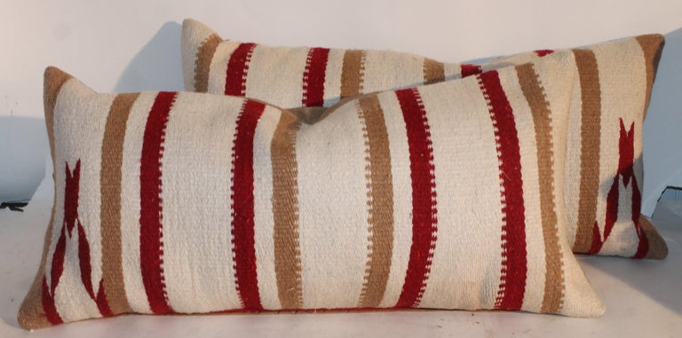 This fine pair of striped Navajo Indian weaving saddle blanket pillows are in great condition.