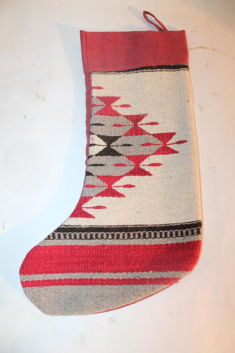 This fine pair of Indian weaving stockings have mauve cotton linen backings. The condition are very good.